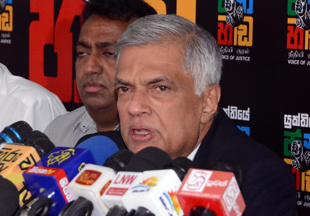 Sri Lanka's ousted Prime Minister Ranil Wickremesinghe speaks during a media conference in Colombo on Tuesday. — AFP
