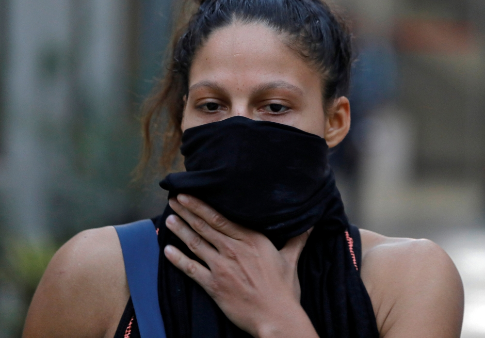 Colombian boxer Dayana Cordero covers her face with a cloth after her practice session ahead of AIBA Women's World Boxing Championships at Indira Gandhi Indoor Stadium in New Delhi, India, on Monday. — Reuters