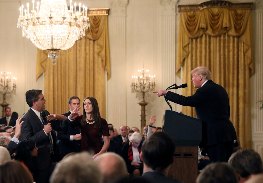 A White House staff member reaches for the microphone held by CNN's Jim Acosta as he questions US President Donald Trump during a news conference following midterm congressional elections at the White House in Washington in this Nov. 7, 2018 file photo. — Reuters