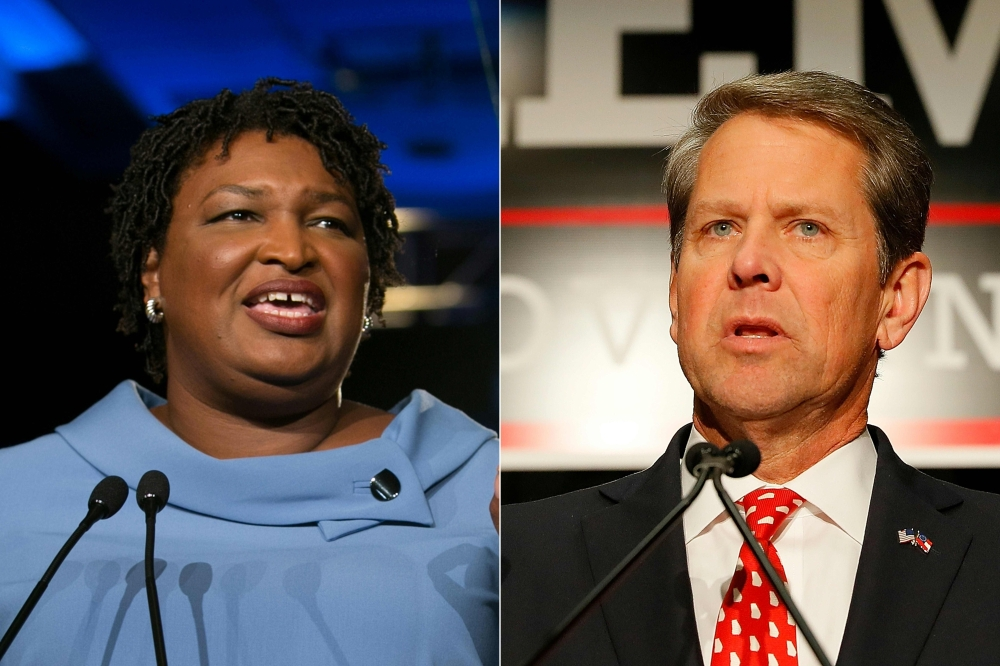 This combination of file pictures created on Nov. 07, 2018 shows Democratic gubernatorial candidate Stacey Abrams, left, and Republican candidate Brian Kemp. — AFP