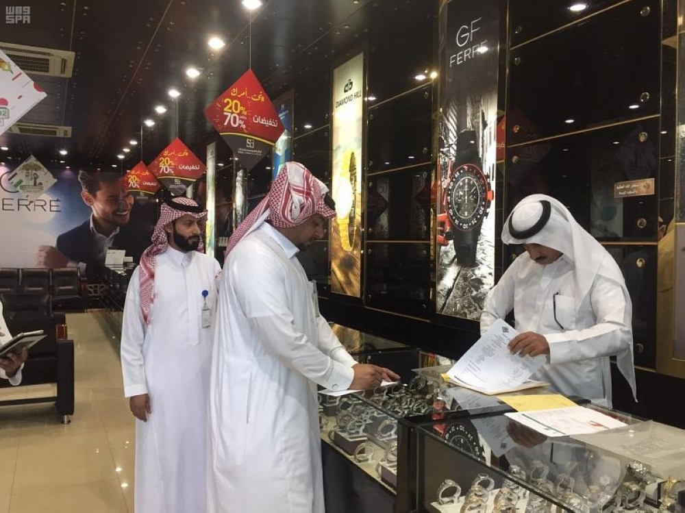 Inspectors from the Labor Ministry visit an outlet for watches in Najran.