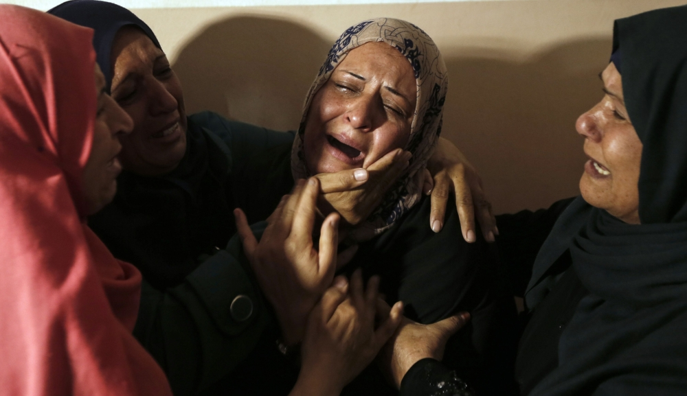 Relatives mourn the death of Hamad Al-Nahal, a Palestinian killed in an Israeli air strike on the Gaza Strip a day earlier, during his funeral in Rafah, on Tuesday. — AFP