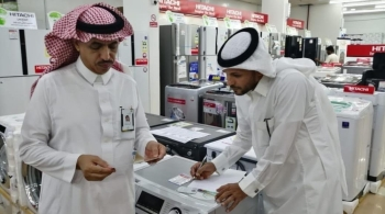 Labour Ministry officials inspect an electrical appliances shop in Al-Jouf.
