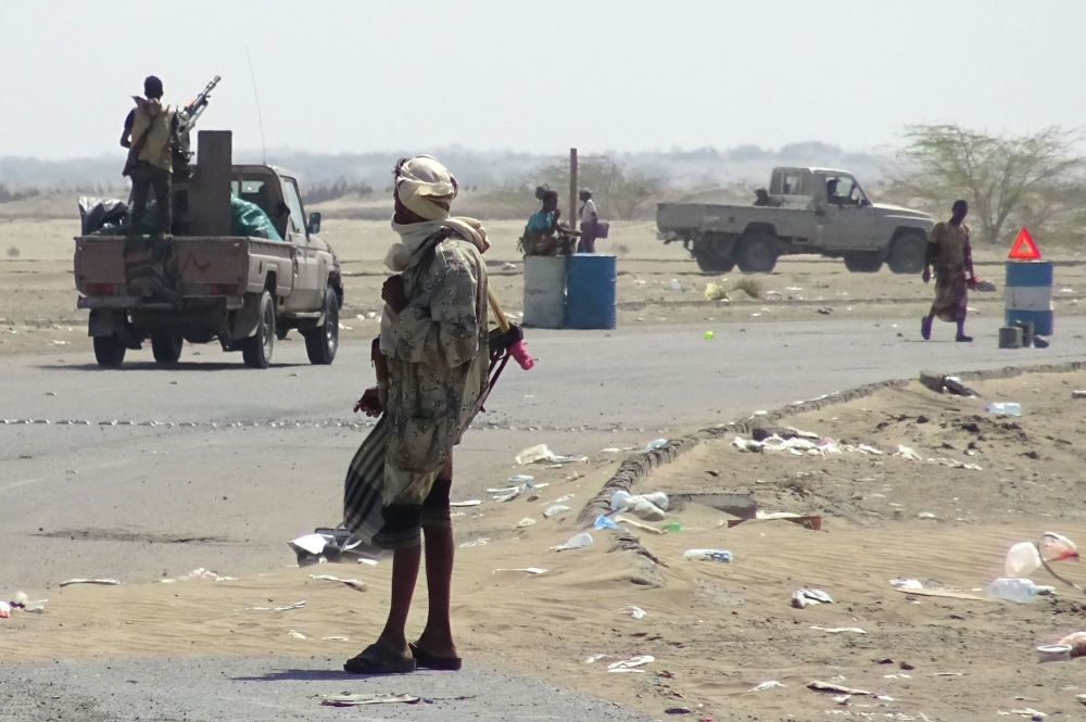 Yemeni pro-government forces gather at a checkpoint in a street on the eastern outskirts of Hodeida. — AFP