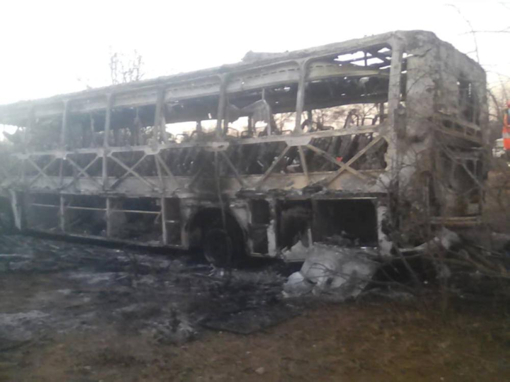 The burned out remains of a passenger bus that caught fire are seen near Beitbridge, Zimbabwe, on Friday. — Reuters