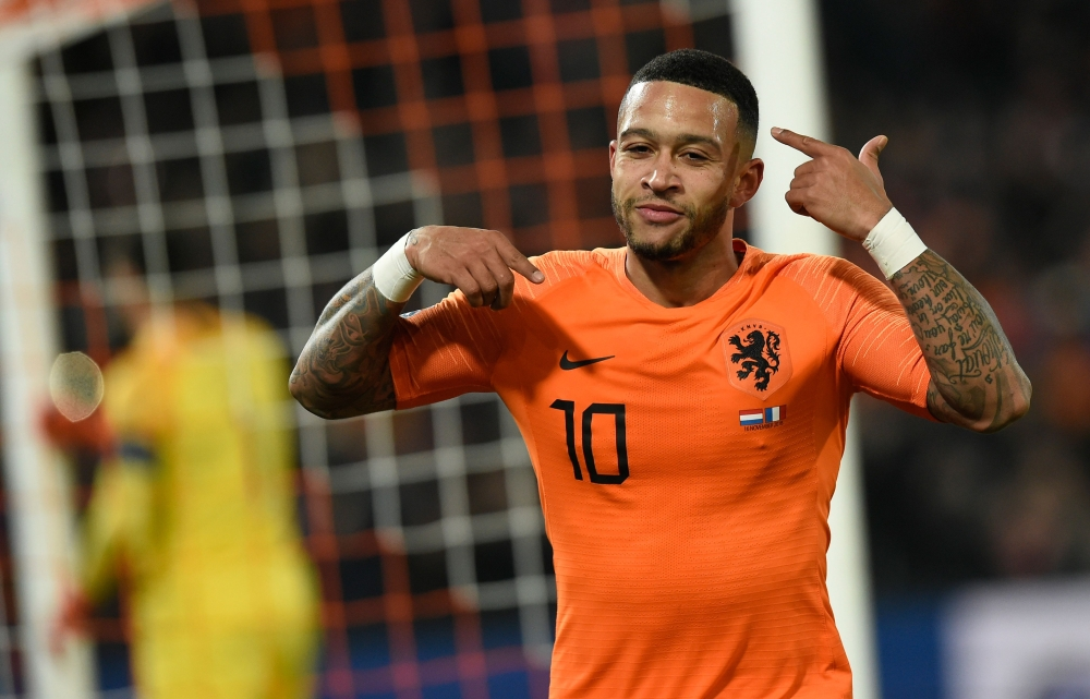Netherlands' forward Memphis Depay celebrates after scoring a goal during the UEFA Nations League football match between the Netherlands and France at the Feijenoord stadium in Rotterdam on Friday. — AFP
