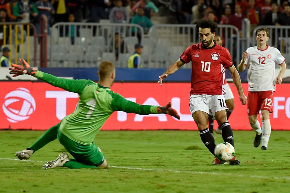 Egypt's forward Mohamed Salah (R) scores a goal during the Africa Cup of Nations qualifier football match Egypt vs Tunisia at the Borg El Arab Stadium, near Alexandria, on Friday. — AFP