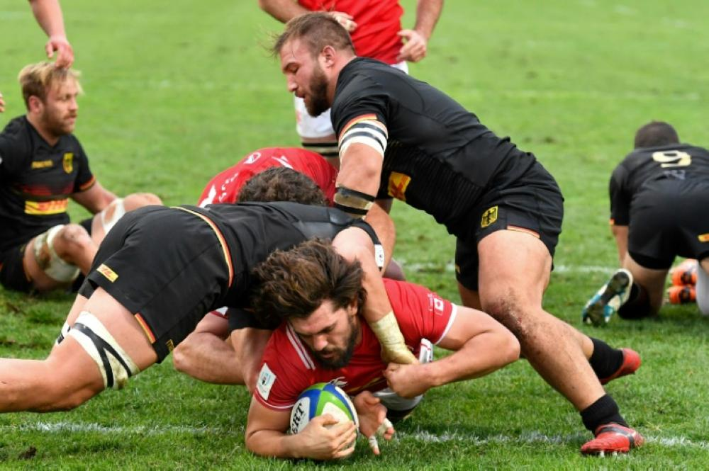 Canada's Lucas Rumball crosses to help his side side a 29-10 World Cup qualifier win over Germany. — AFP