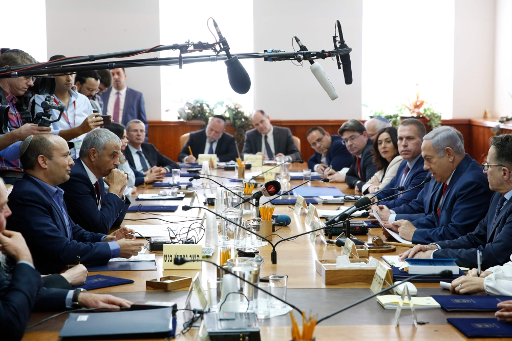 Israeli Prime Minister Benjamin Netanyahu (2nd right), Minister of Education Naftali Bennett (1st left) and finance minister Moshe Kahlon (2nd left) attend a Cabinet meeting in occupied Jerusalem, Sunday. — AFP