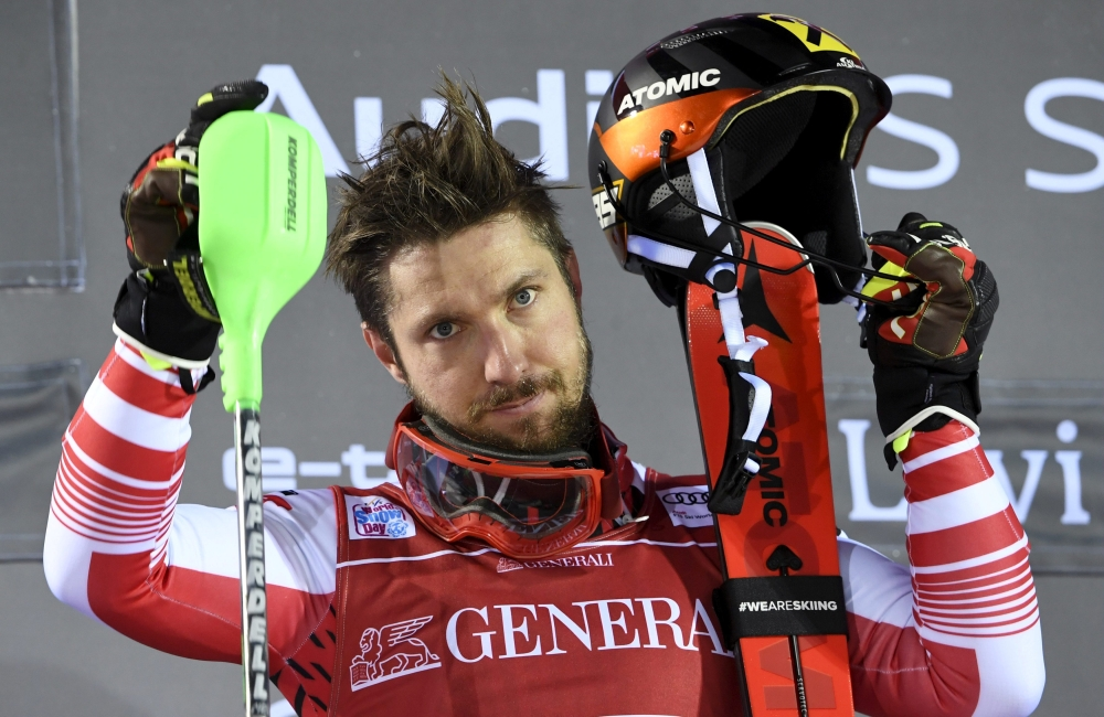 Winner Marcel Hirscher of Austria celebrates on the podium after the second run during the FIS Alpine Ski World Cup  Mens' Slalom at the Levi, Kittila, Finland, on Sunday. — Reuters