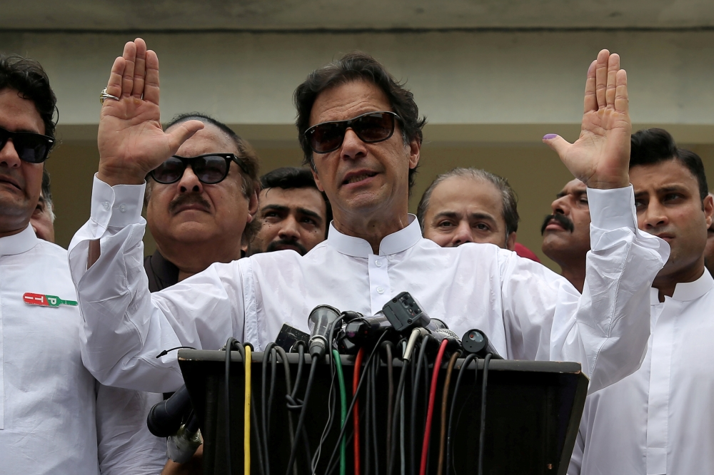 Pakistani Prime Minister Imran Khan speaks to members of media after casting his vote at a polling station during the general election in Islamabad in this July 25, 2018 file photo. — Reuters