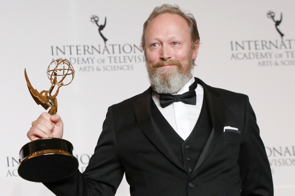 Danish actor Lars Mikkelsen poses with award for Performance by an Actor for his role in Herrens Veje (Ride Upon the Storm) at the International Emmy Awards in Manhattan, New York City. — Reuters