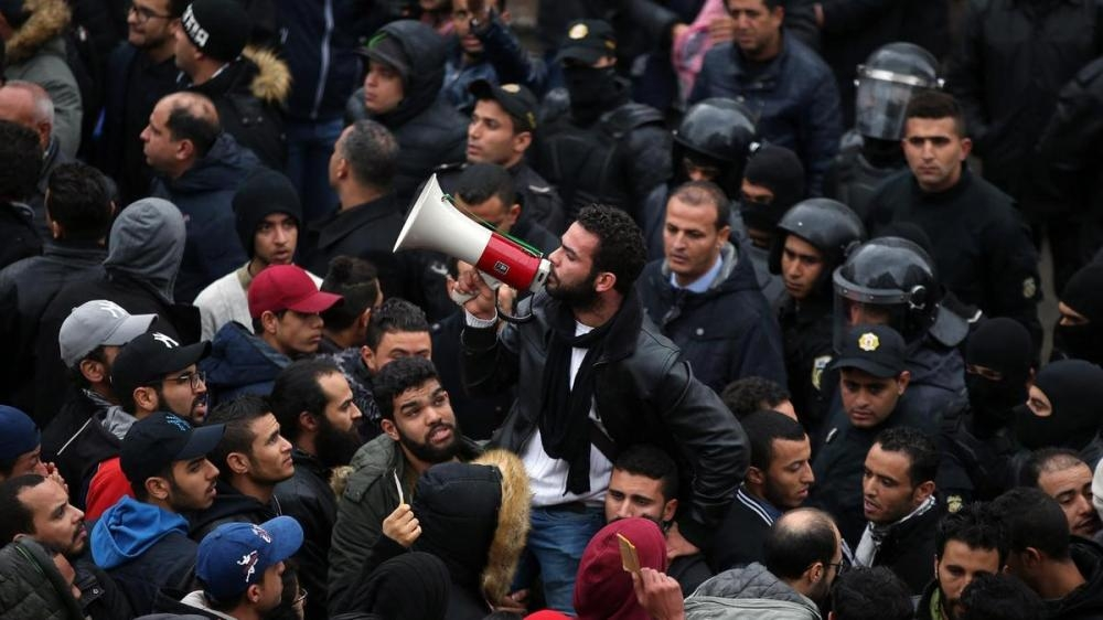 Tunisian protesters during a demonstration after the government announced tax hikes and austerity measures. — Archives