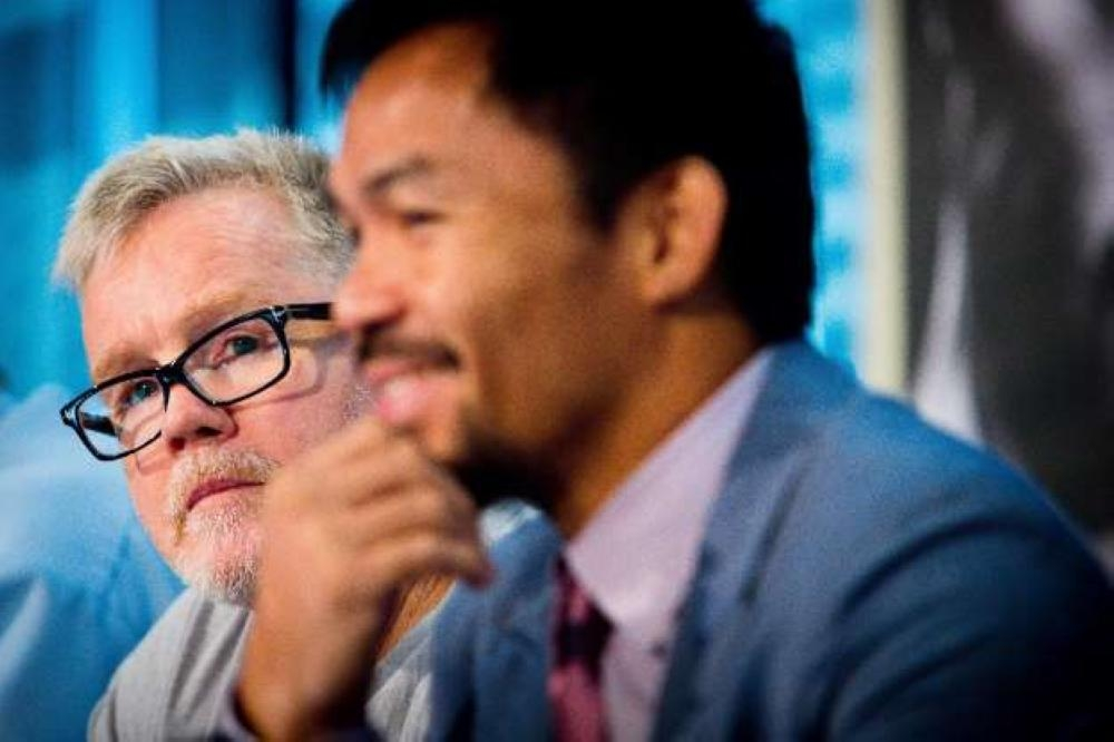 Filipino star Manny Pacquiao, seen in this file photo, admits he has not spoken with former trainer Freddie Roach about a possible reunion. — AFP