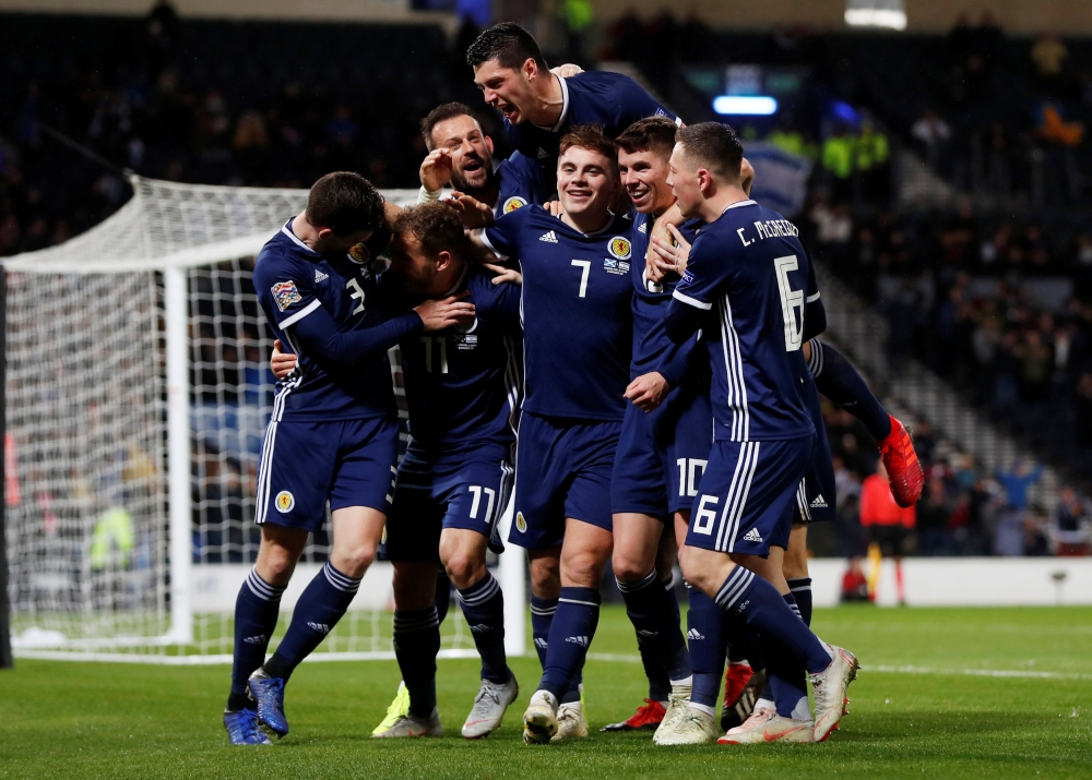 Scotland's James Forrest celebrates scoring their third goal to complete his hat-trick against Israel during the UEFA Nations League - League C - Group 1match at Hampden Park, Glasgow, Britain, on Tuesday. — Reuters