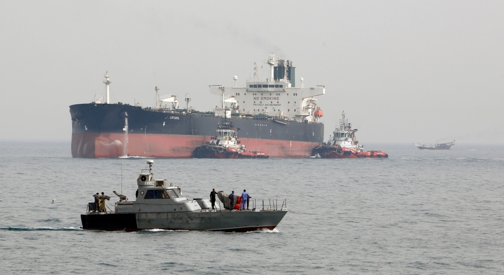 In this file photo taken on March 12, 2017, an Iranian military speedboat patrols the waters as a tanker prepares to dock at the oil facility in the Khark Island, Iran. The US slapped fresh sanctions on Iran Tuesday, accusing it of creating a complex web of Russian cut-out companies and Syrian intermediaries to ship oil to Damascus, which in turn bankrolled Hezbollah and Hamas. — AFP