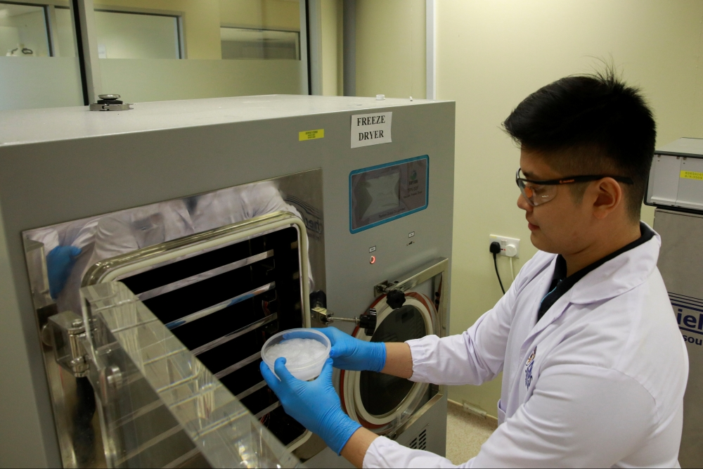 An NUS researcher cures an Aerogel sample at NUS's Department of Mechanical Engineering in Singapore. — Reuters