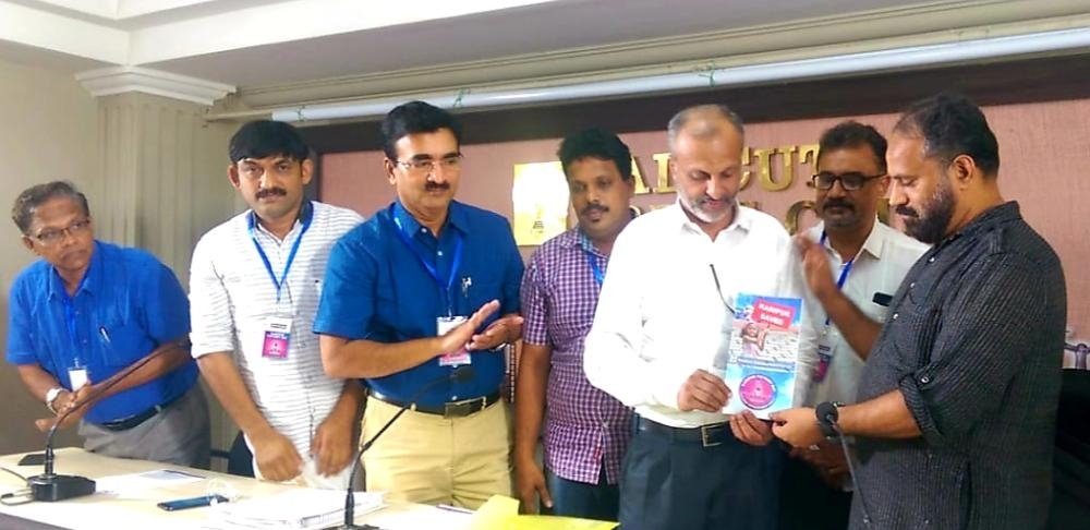 Kamal Varadoor, president of Kerala Union of Working Journalists, launching the booklet issued by Malabar Development Forum on the occasion of its Karippur Victory Day in Calicut on Monday. K.M Basheer, president of MDF, and other officials are also seen.