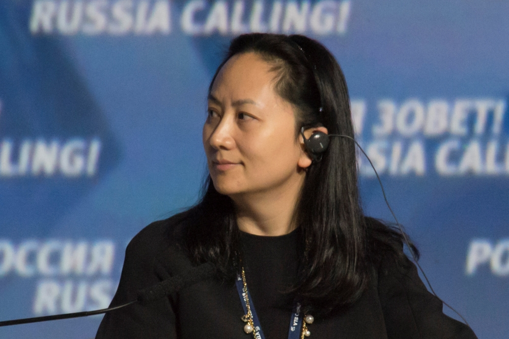 Meng Wanzhou, Executive Board Director of the Chinese technology giant Huawei, attends a session of the VTB Capital Investment Forum