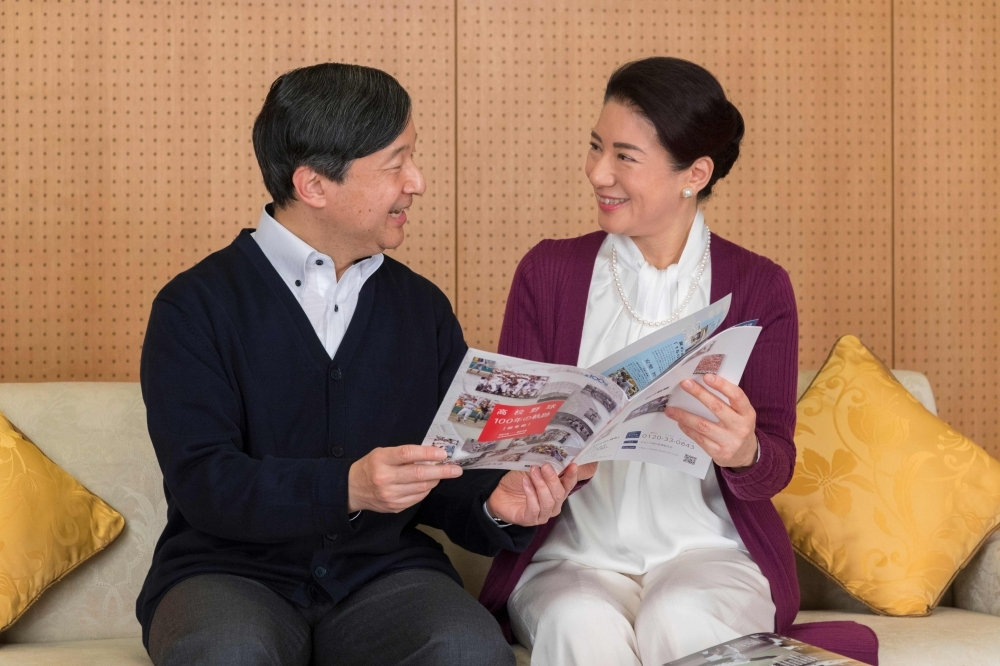 This handout picture provided by the Imperial Household Agency of Japan shows Japan's Crown Princess Masako (R) and her husband Crown Prince Naruhito (L) sharing a book at Togu Palace in Tokyo. — AFP