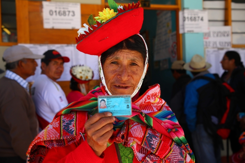 A woman shows her identity card at a polling station in Ollantaytambo, a town located in what is known as the Sacred Valley of the Incas in the province of Urubamba, Cusco region, in southern Peru, as the country votes on President Martin Vizcarra's constitutional reforms aimed at eradicating corruption, on Sunday. — AFP