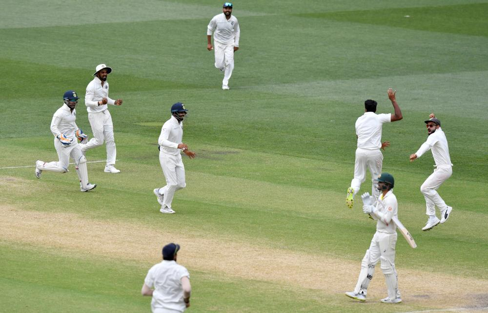 India's players celebrate after they defeated Australia on day five of the first Test match at the Adelaide Oval Monday. — AFP