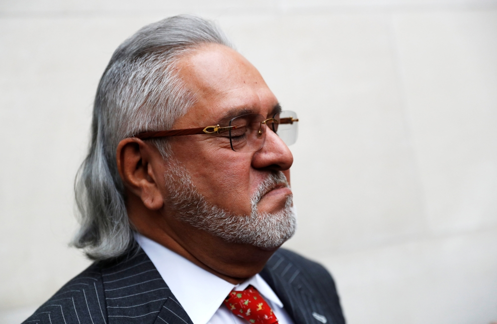 Vijay Mallya has a break outside the court house as he waits for his extradition case to be heard at Westminster Magistrates Court, in London, Britain, on Monday. — Reuters