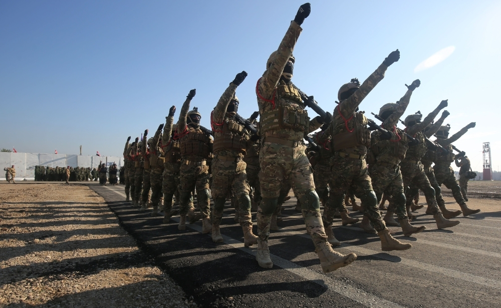 Members of Iraq's Rapid Response military unit take part in a parade at a military base inside Baghdad's International Airport on Monday to mark the first anniversary of the country's victory over the Daesh group. — AFP