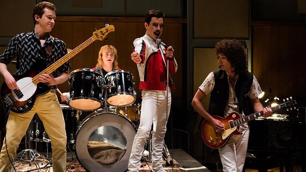 L-R: Joe Mazzello (John Deacon), Ben Hardy (Roger Taylor), Rami Malek (Freddie Mercury), and Gwilym Lee (Brian May) star in Twentieth Century Fox's BOHEMIAN RHAPSODY. — Photo Credit: Alex Bailey