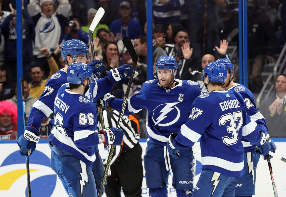 Tampa Bay Lightning center Steven Stamkos (C) is congratulated by teammates after he scored a goal against the New York Rangers during their NHL game at Amalie Arena in Tampa Monday. — Reuters