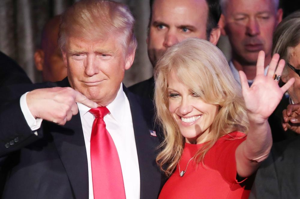 US President-elect Donald Trump and his campaign manager Kellyanne Conway acknowledge the crowd during his election night event at the New York Hilton Midtown in the early morning hours in New York City in this Nov. 9, 2016 file photo. — AFP