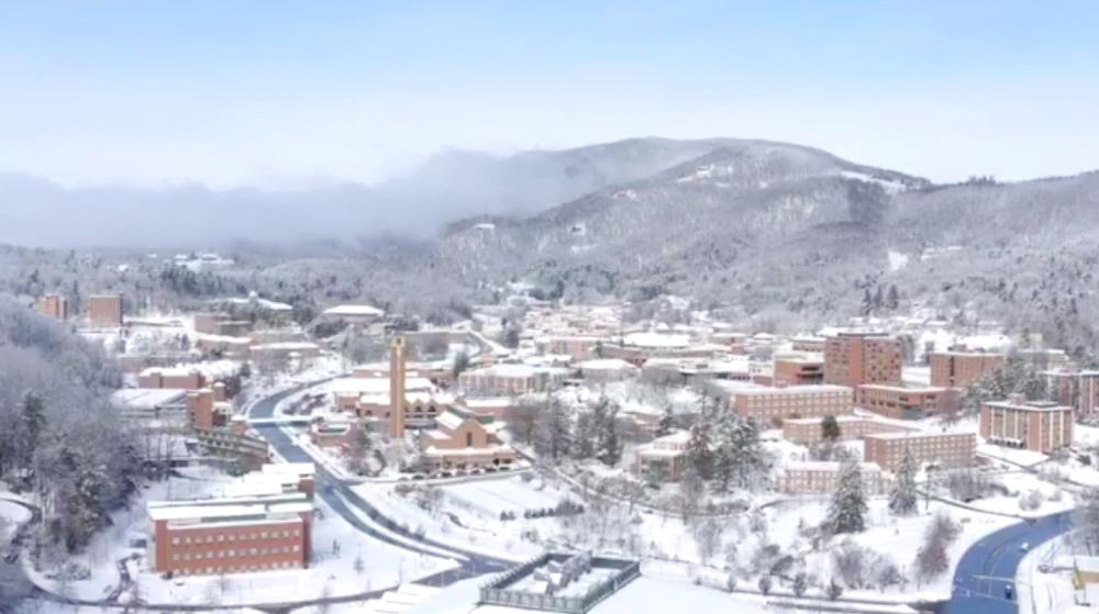 An aerial view shows snow over the Appalachian State University in Boone, North Carolina, on Monday in this still image taken from a social media video. — Reuters