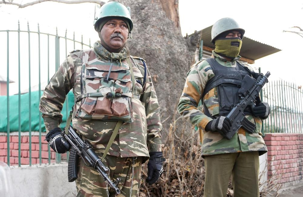 Indian paramilitary personnel stand guard in Srinagar on Tuesday, as security tightens following an attack on a police post at Zainpora village in southern Kashmir valley. — AFP