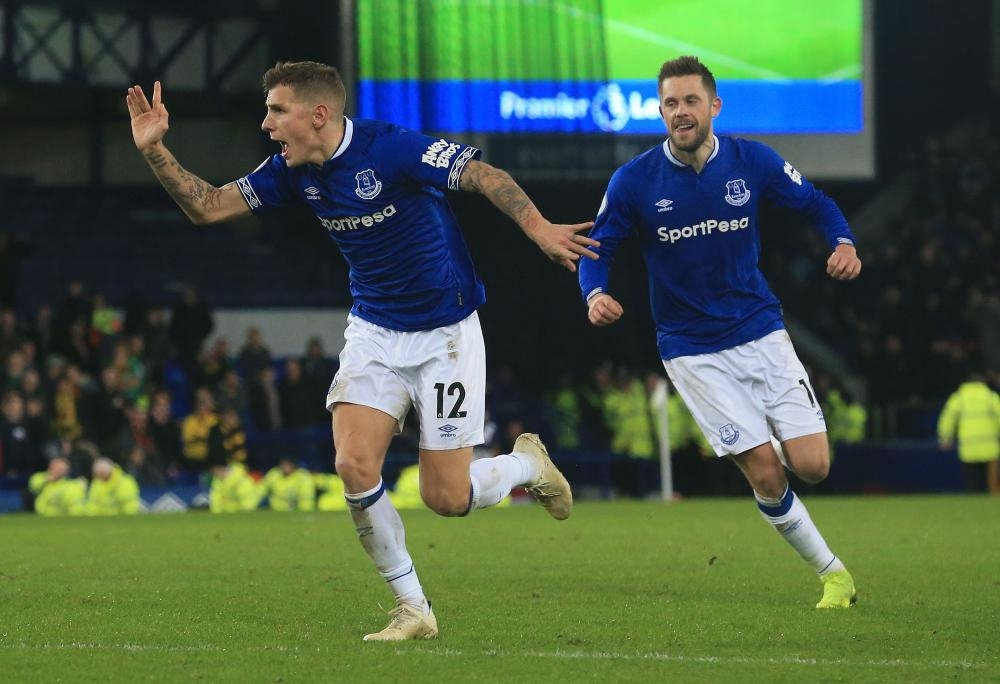 Everton's defender Lucas Digne (L) celebrates scoring his team's second goal during the English Premier League match against Watford at Goodison Park in Liverpool Monday. — AFP