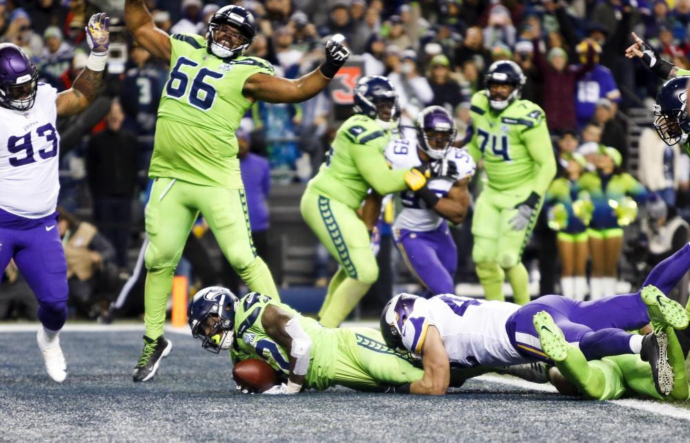 Seattle Seahawks' running back Chris Carson rushes for a touchdown against the Minnesota Vikings during their NFL game at CenturyLink Field in Seattle Monday. — Reuters