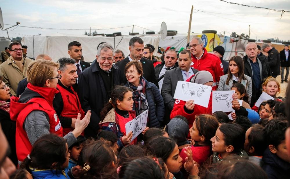 Austrian President Alexander Van der Bellen (3rd-L) and his wife Doris Schmidauer (4th-L) meet with Syrian refugee children at a camp near the village of Hawsh Al-Nabi, in Lebanon's eastern Bekaa valley. — AFP