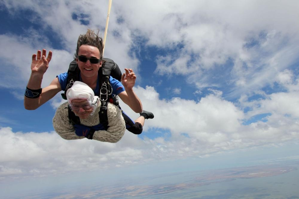 This handout photo released by SA Skydiving shows 102-year-old great-grandmother Irene O'Shea during her skydive tandem jump over Wellington in South Australia. — AFP