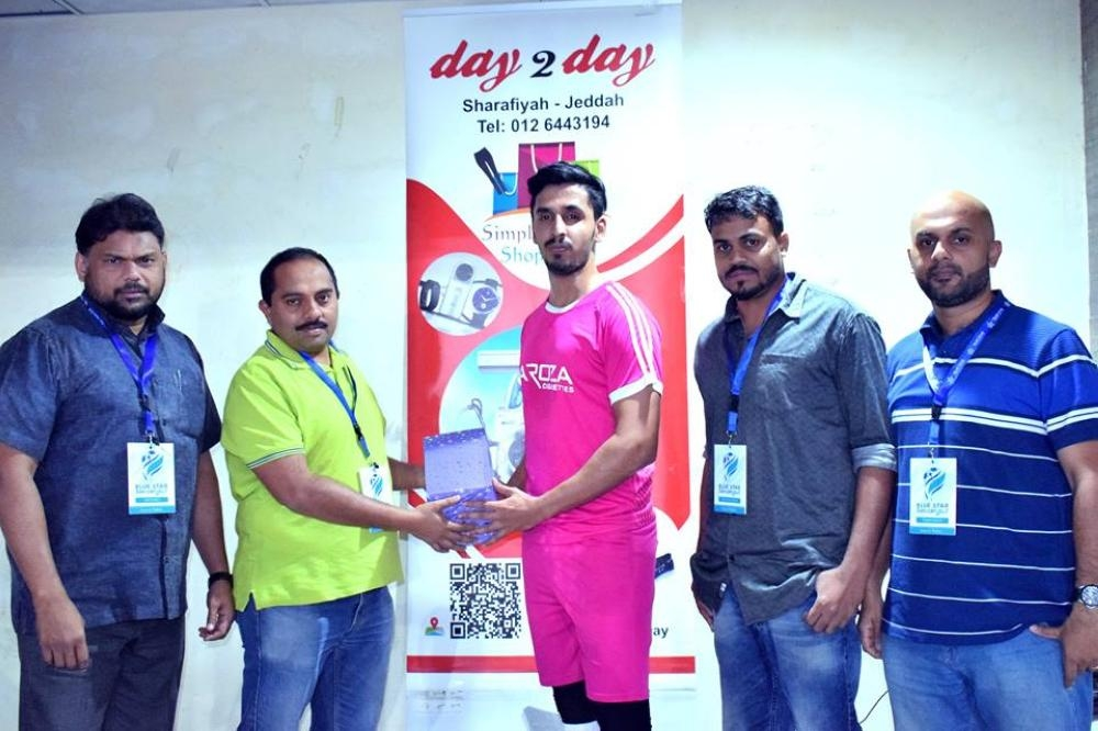Player of the Match Emad of ACC receives the prize from Babu Neelambra.