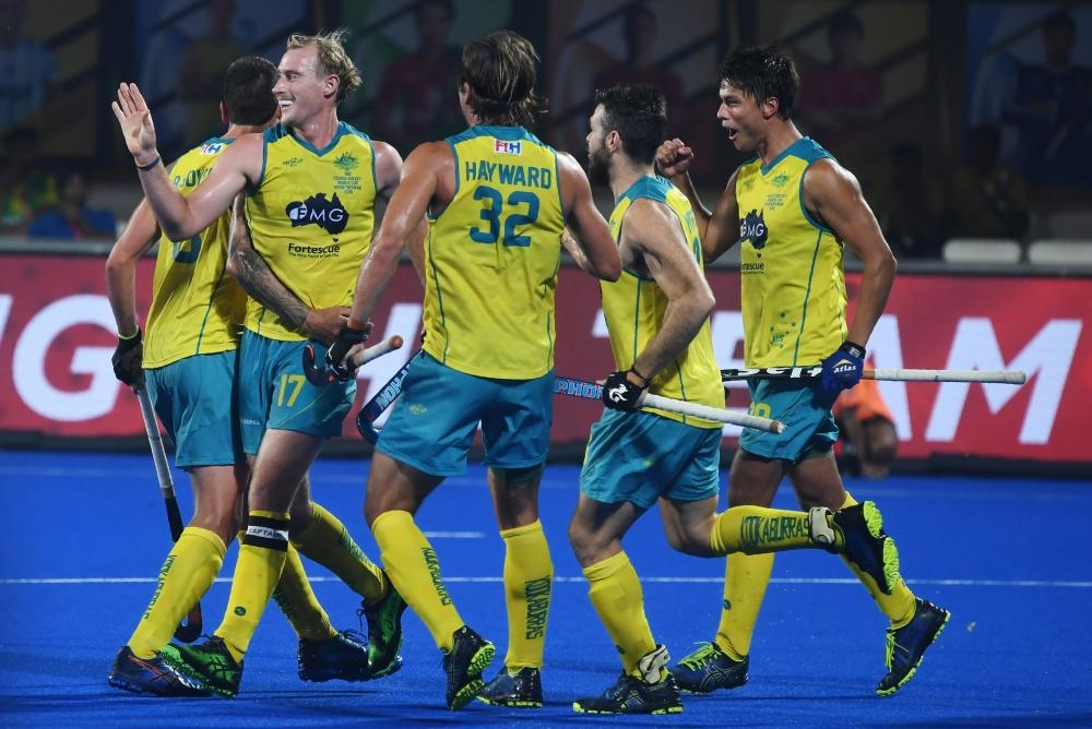 Australia's captain Aran Zalewski (2nd L) celebrates with teammates after scoring a goal against France during their field hockey quarterfinal match at the 2018 Hockey World Cup in Bhubaneswar Wednesday.  — AFP