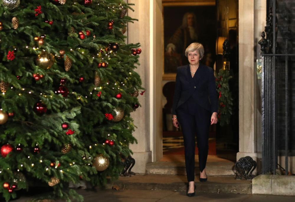 Britain's Prime Minister Theresa May arrives to make a statement outside 10 Downing Street in central London after winning a confidence vote on Wednesday — AFP