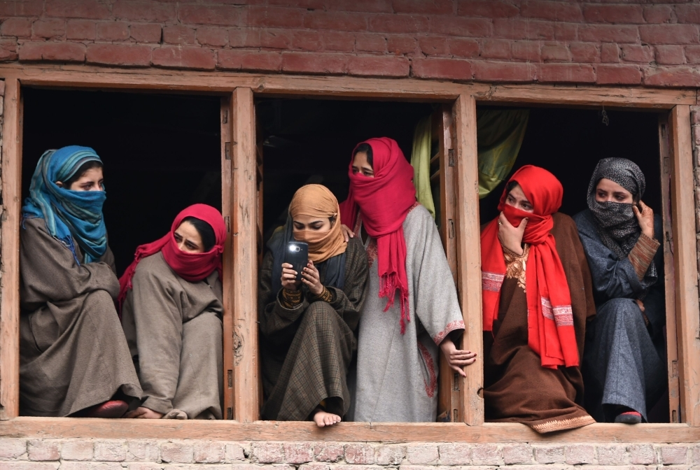 Kashmiri villagers watch from a balcony during a funeral procession in Hajin,north of Srinagar, in this Dec. 10, 2018 file photo. — AFP