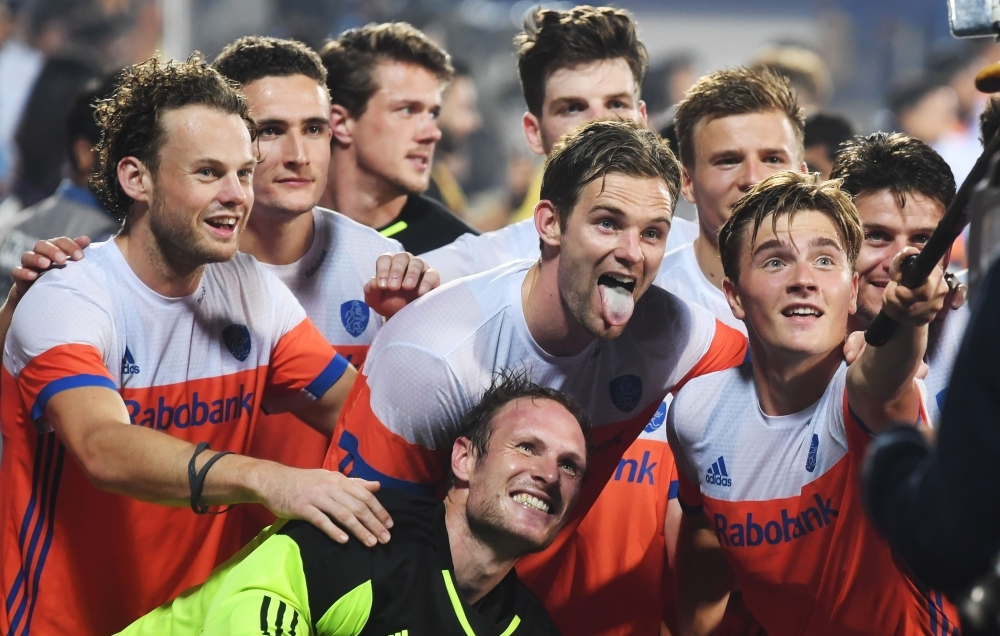 Netherlands players pose for a selfie as they celebrate their team's win over India after the field hockey quarterfinal match at the 2018 Hockey World Cup in Bhubaneswar on Thursday. Netherlands won 2-1. — AFP