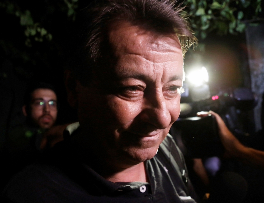 Italian former leftist guerrilla Cesare Battisti leaves the headquarters of Federal Police in Sao Paulo, Brazil, in this March 13, 2015 file photo. — Reuters