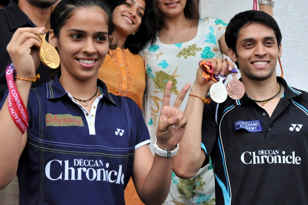 Indian badminton players Saina Nehwal, left, and Parupalli Kashyap pose with their New Delhi Commonwealth Games medals prior to a press conference in Hyderabad in this Oct. 16, 2010 file photo. — AFP