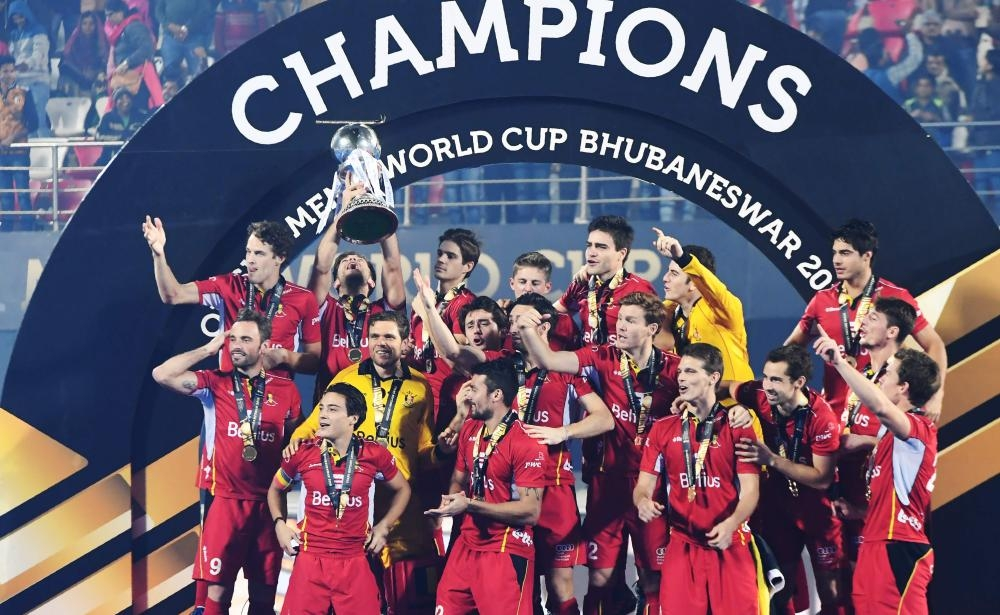 Belgium's players celebrate with the world cup trophy after defeating Netherlands in the field Hockey final at the 2018 Hockey World Cup in Bhubaneswar Sunday. — AFP