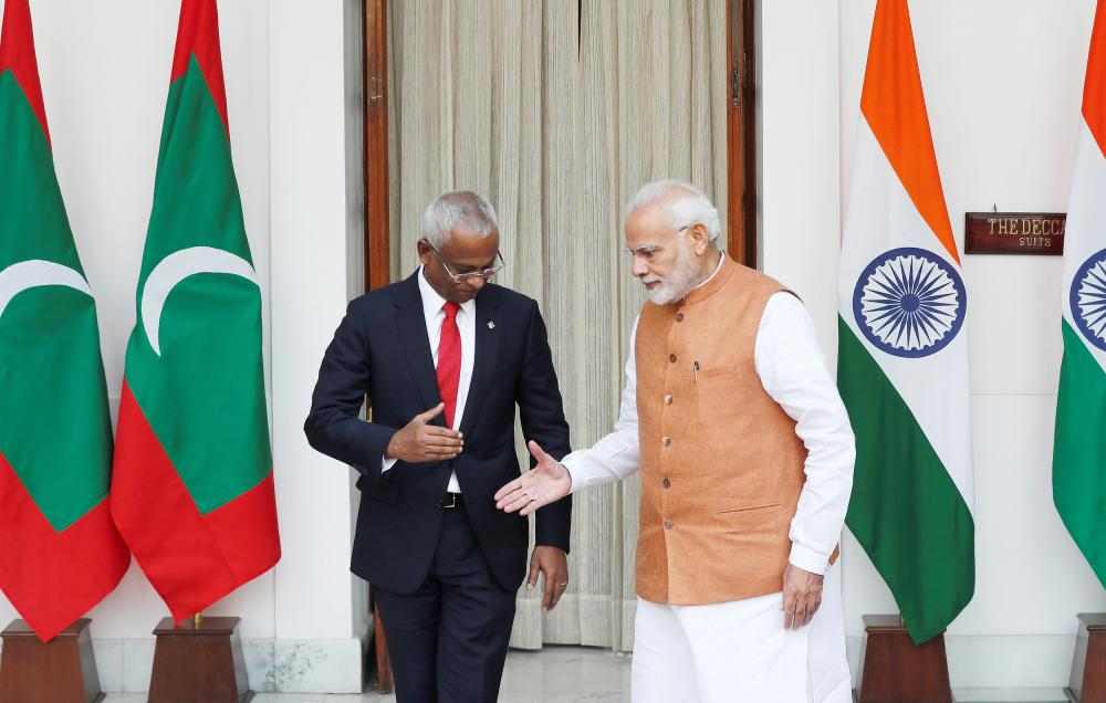 Maldives President Ibrahim Mohamed Solih and Indian Prime Minister Narendra Modi shake hands ahead of their meeting at Hyderabad House in New Delhi on Monday. — Reuters