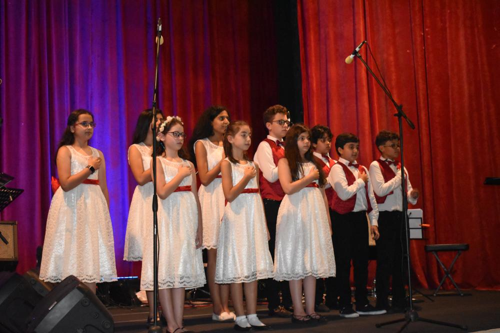 "Pupils from the Italian School in Jeddah singing ""Fratelli d'Italia"", the Italian national anthem at the ceremony."