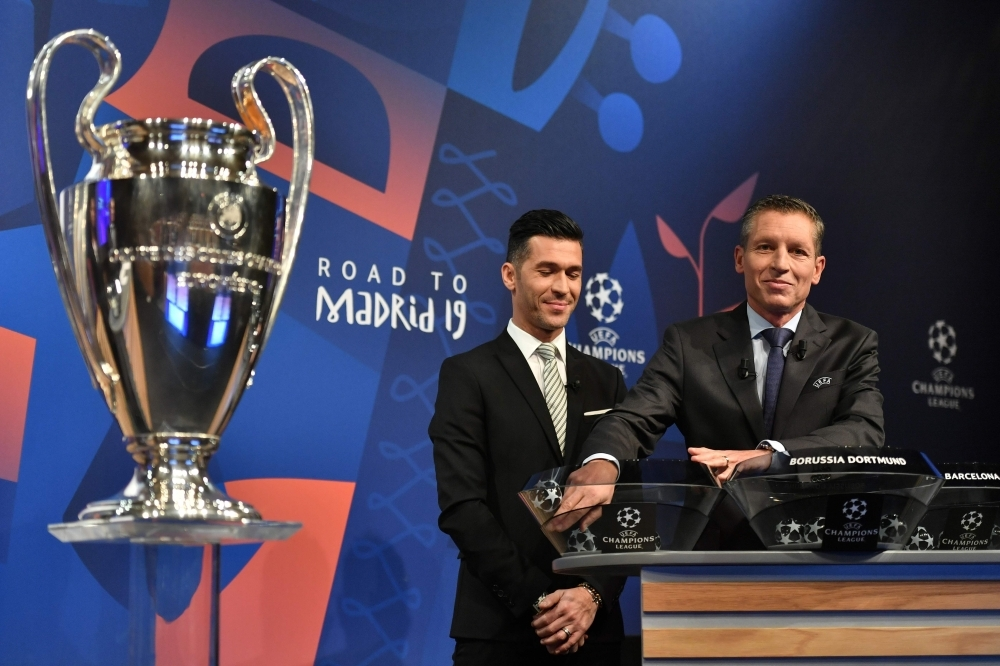Former Spanish football player Luis Garcia (L) and UEFA head of club competitions Michael Heselschwerdt attend the draw for the round of 16 of the UEFA Champions League football tournament at the UEFA headquarters in Nyon Monday. — AFP