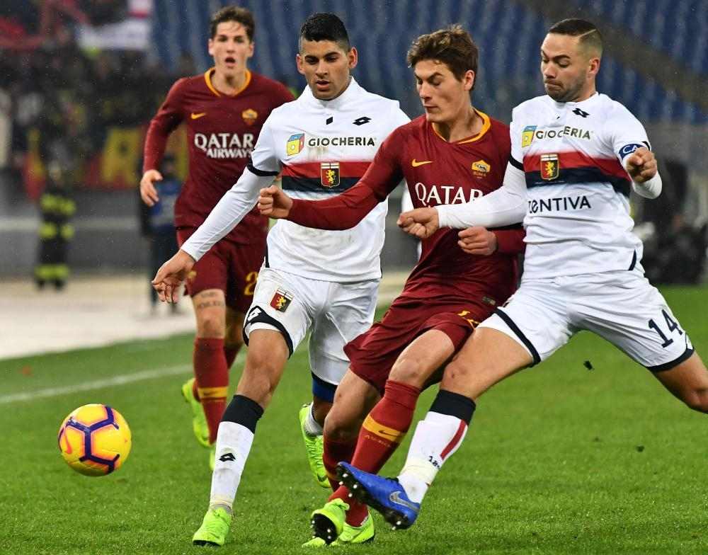 AS Roma's forward Patrik Schick (2nd R), Genoa's defenders Davide Biraschi (R) and Cristiano Romero go for the ball during their Italian Serie A football match at the Olympic Stadium in Rome Sunday. — AFP