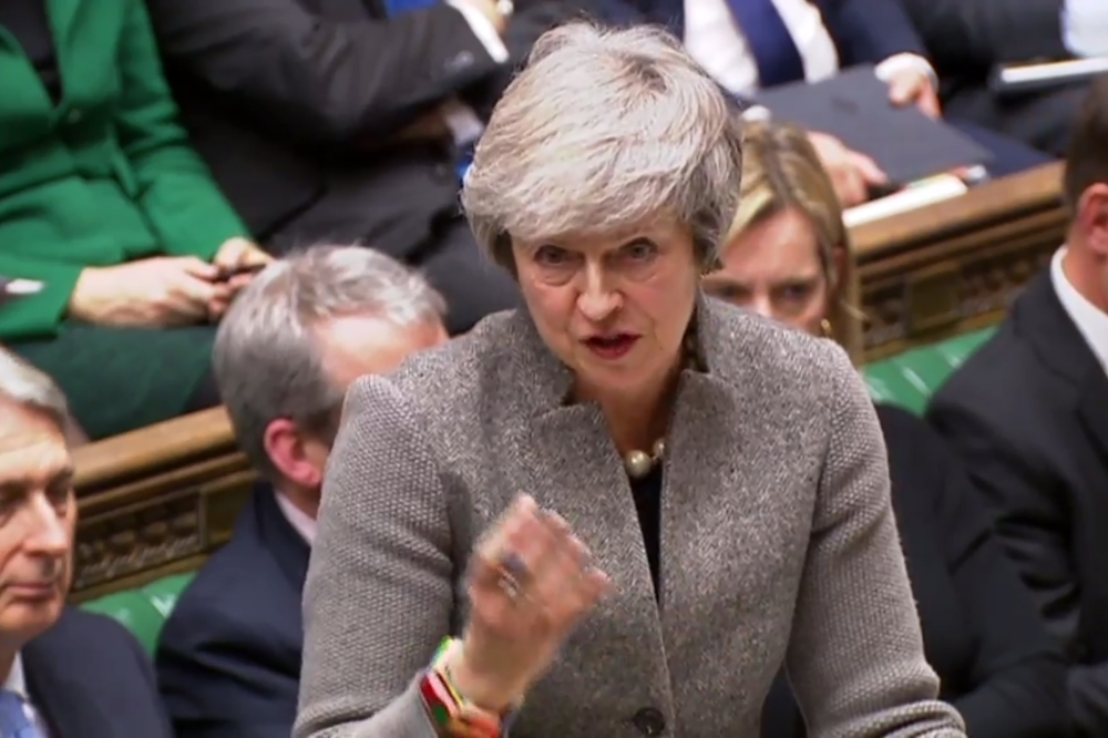 A video grab from footage broadcast by the UK Parliament's Parliamentary Recording Unit (PRU) shows Britain's Prime Minister Theresa May answering questions after making a statement to the House of Commons in London on Monday. — AFP